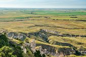 Nebraska farmland as seen from a summit of Scotts Bluff National monument in late summer scenery, tr poster
