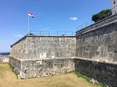 A View Of The Walls Of Pula Castle, A Venetian Fortress And Popular Tourist Site.  The Croatian Flag poster