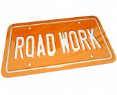 An orange metal license plate with the words Road Work communicating that there is roadwork ahead an