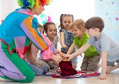 Group Of Happy Smiling Preschool Kids Watching At Clown Show Indoor. Party For Children. poster