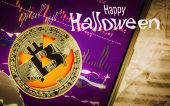 Happy Halloween Cryptocurrency Trading Concept. Spooky Golden Bitcoin With Jack-o-lantern Face On Sm poster