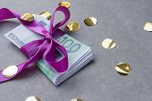 Hundred Euro Banknotes On A Stack With Violet Bow. Gift, Bonus Or Reward Concept poster