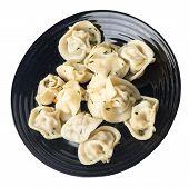 Dumplings On A Black Plate Isolated On White Background .boiled Dumplings.meat Dumplings Top Side Vi poster