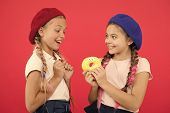 Kids Huge Fans Of Baked Donuts. Share Sweet Donut. Girls In Beret Hats Hold Glazed Donut Red Backgro poster