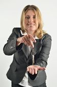 Businesswoman Holding Up A Pair Of Keys