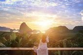 Woman With The White Dress Sit And See The Mountain In Early Morning  At Samet Nangshe Viewpoint In  poster