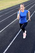 Runner Athlete Running On Athletic Track Training Her Cardio In Stadium. Jogging At Fast Pace For Co poster