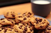 image of chocolate-chip  - A stack of cookies threatens to topple over - JPG