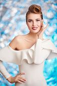Portrait of a beautiful charming woman in elegant white dress. Pin-up style in clothes, hair and mak poster