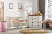 Cozy Baby Room Interior With Comfortable Crib poster