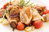 stock photo of cockerels  - Chicken fillet with mushrooms and tomatos - JPG