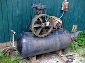 stock photo of chug  - still chugging along old antique air compressor