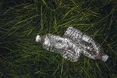 Ecology Concept. Plastic Bottles In The Green Grass. The Problem Of Ecology, Environmental Pollution poster