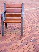 stock photo of lien  - An empty chair on a red bricks - JPG