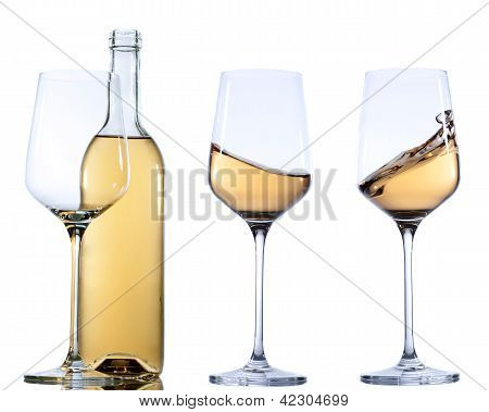 Set of glass with white wine on white background.