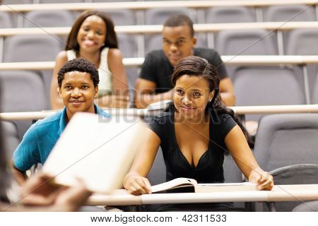 college professor lecturing group of african students in classroom