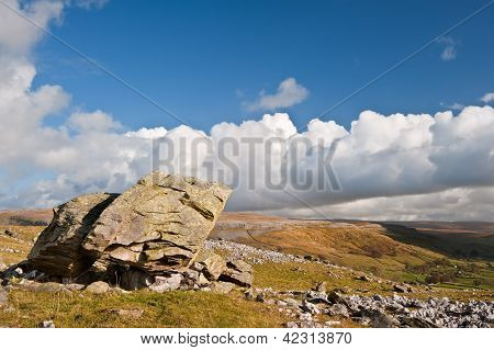 Norber Erratics In Yorkshire Dales National Park With Moughton Scar In Background