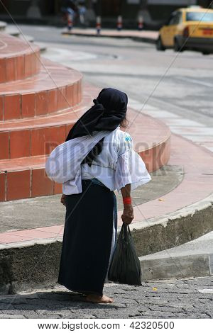 Editorial Use: Indigenous Woman Carrying a Bag