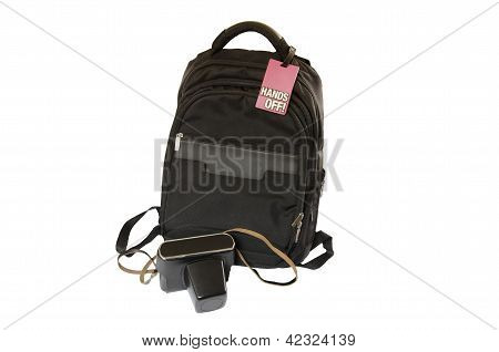 bag with sign on it and camera on white background