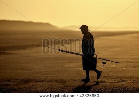 A sunset and a fisher at 80 mile beach Australia