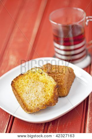 Toasted Corn Muffin With Butter And A Cup Of Tea