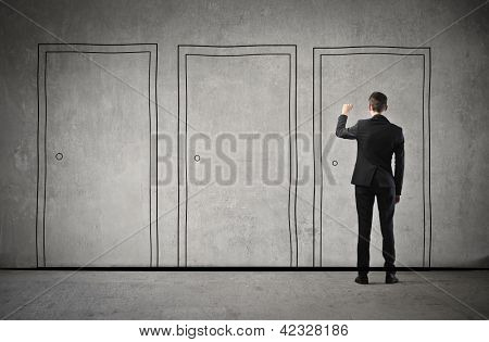 businessman chooses a door