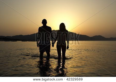 Loving Couple at Sunrise