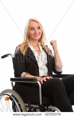 Blond Girl Sitting In A Wheel Chair
