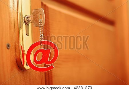 silver key with e-mail symbol in keyhole isolated over white