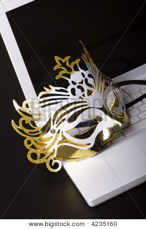 Mardi Gras Mask On A White Laptop