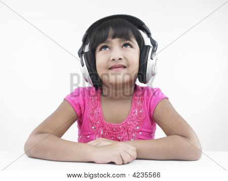 A Pretty Looking Asian Girl Of Indian Origin Listening To Music