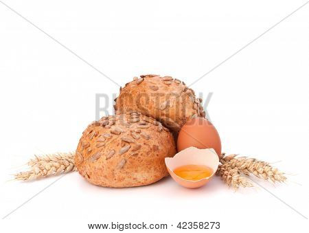 Bun with seeds and broken egg isolated on white background