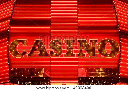 Casino entrance sign in red neon lights