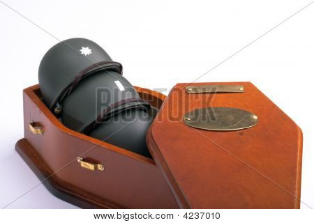 Army Helmets In Coffin