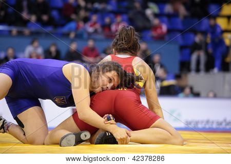 KIEV, UKRAINE - FEBRUARY 16: Match between Synyshyn, Ukraine, red and Husiak, Ukraine during XIX International freestyle wrestling and female wrestling tournament in Kiev, Ukraine on February 16, 2013