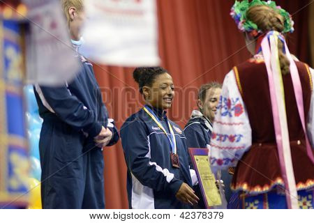 KIEV, UKRAINE - FEBRUARY 16: Lampe, USA (left), Anthony, USA (center) and Livach, Ukraine on award ceremony during XIX International female wrestling tournament in Kiev, Ukraine on February 16, 2013