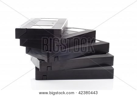 A stack of video cassettes isolated on white background.