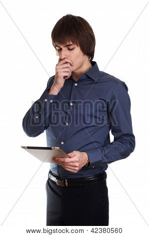 Young Businessman think about something with tablet in his hand