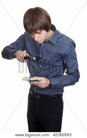 young Businessman look into small book with loupe. isolated on w