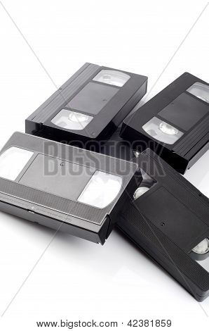 Pile of video cassettes isolated on white background.