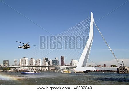 ROTTERDAM, NETHERLANDS - SEPTEMBER 09: Army helicopter is flying in front of the erasmus bridge during the world harbor days on 9 september 2012 Rotterdam the Netherlands