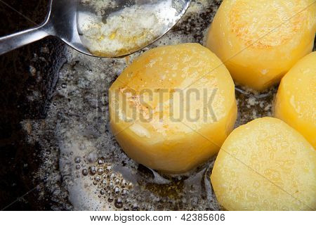 Fondant Potato Frying In Sauce Pan. Butter Basting Food With Spoon Whilst Cooking. Gourmet Restauran