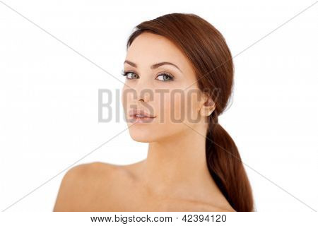 Portarit of a beautiful dark haired girl in a pony tail  isolated on white