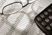 Spreadsheet With Calculator And Glasses