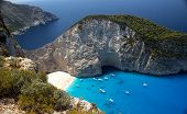 stock photo of crystal clear  - Navagio Beach is located on Zakynthos Island in Greece - JPG