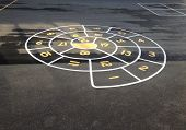 picture of hopscotch  - Circular Hopscotch painted on pavement of school yard - JPG