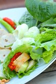 image of nem  - Vegetables cucumber  garlic and lettuce in plate.