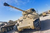 stock photo of panzer  - World War II Sherman tank upgraded with 105 mm cannon in a museum - JPG