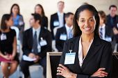 stock photo of audience  - Businesswoman Delivering Presentation At Conference - JPG