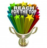 pic of reach the stars  - Reach for the Top words in fireworks and colorful stars shooting out of a gold trophy symbolizing winning a competition or game - JPG